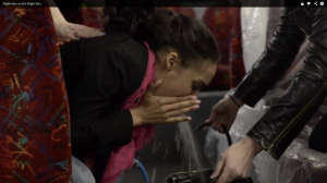 A girl pretends to vomit on the night bus